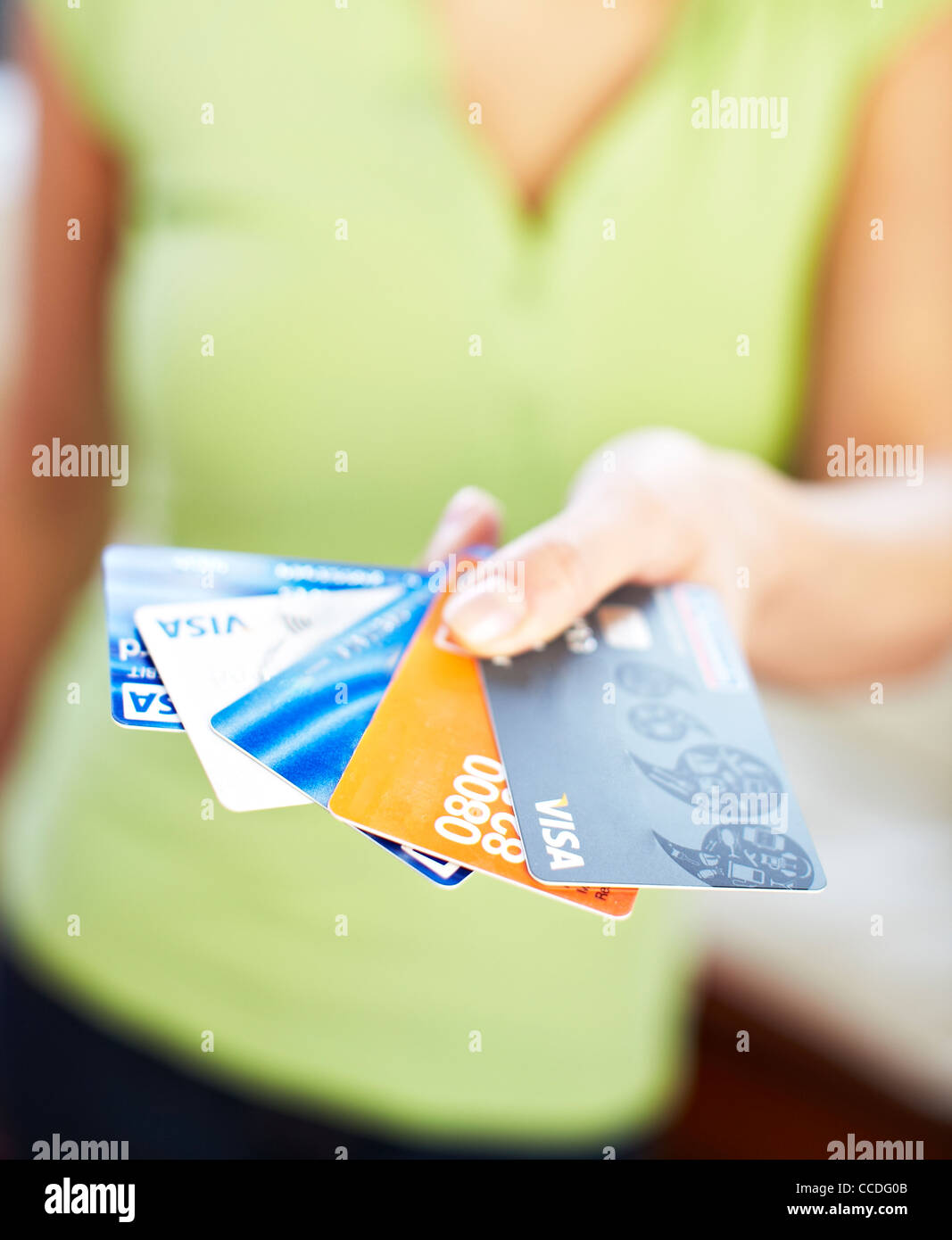 Woman holding credit cards - Stock Image