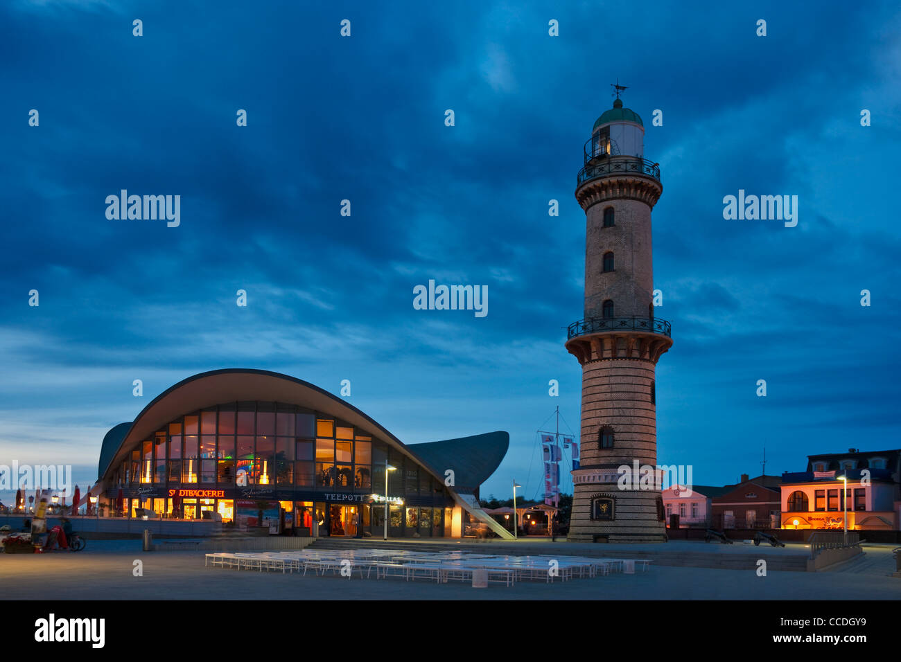 Old lighthouse an Teepot-building in Rostock Warnemuende at night, Rostock, Mecklenburg-Western Pomerania, Germany, - Stock Image