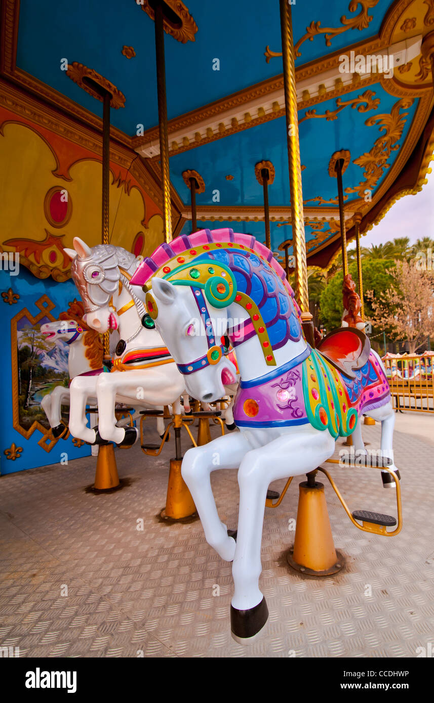 Colorful horses in the carousel Stock Photo