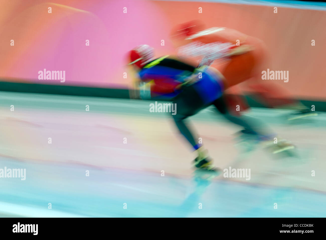 Blurred action of speed skaters. - Stock Image