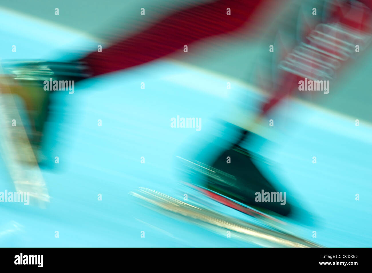 Detail blurred action of speed skater's feet. - Stock Image