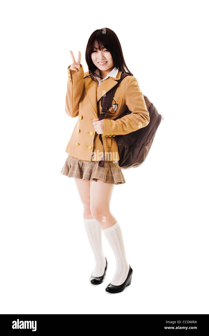 431d62fc8 Female Chinese student wearing a backpack on a white background showing a  peace sign. -