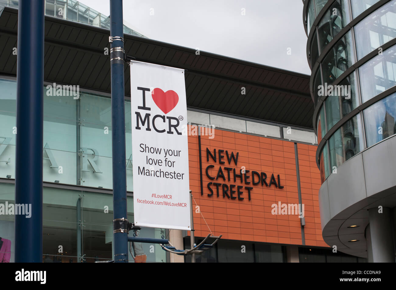 A banner for the I Love Manchester Campaign hung on the corner of New Cathedral Street, Manchester. - Stock Image