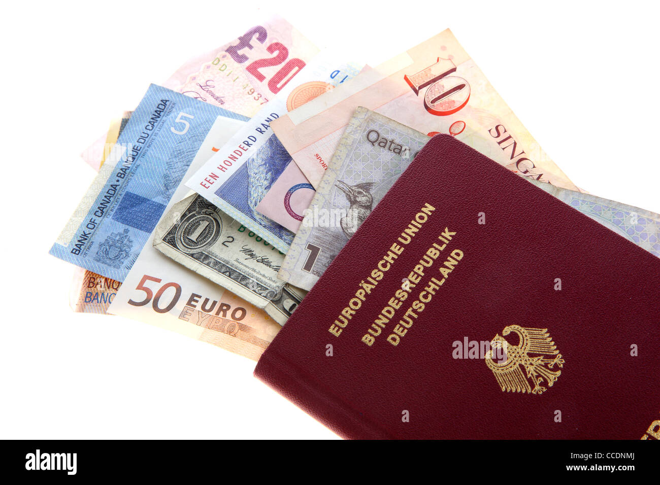 Travel documents, passport and different currencies, bank notes, cash. - Stock Image