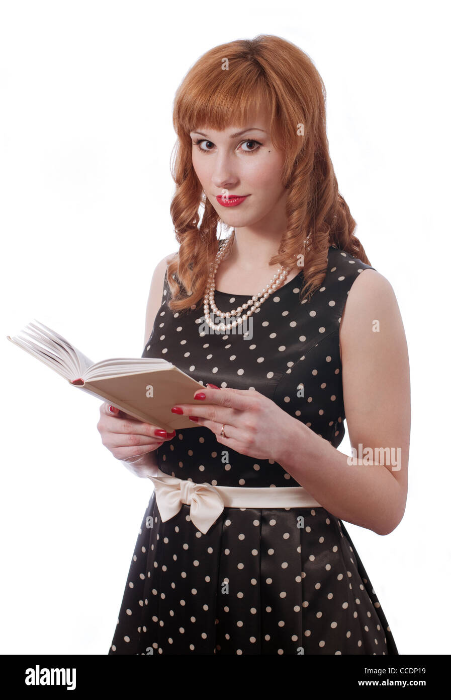 Retro girl with the book in the hands - Stock Image
