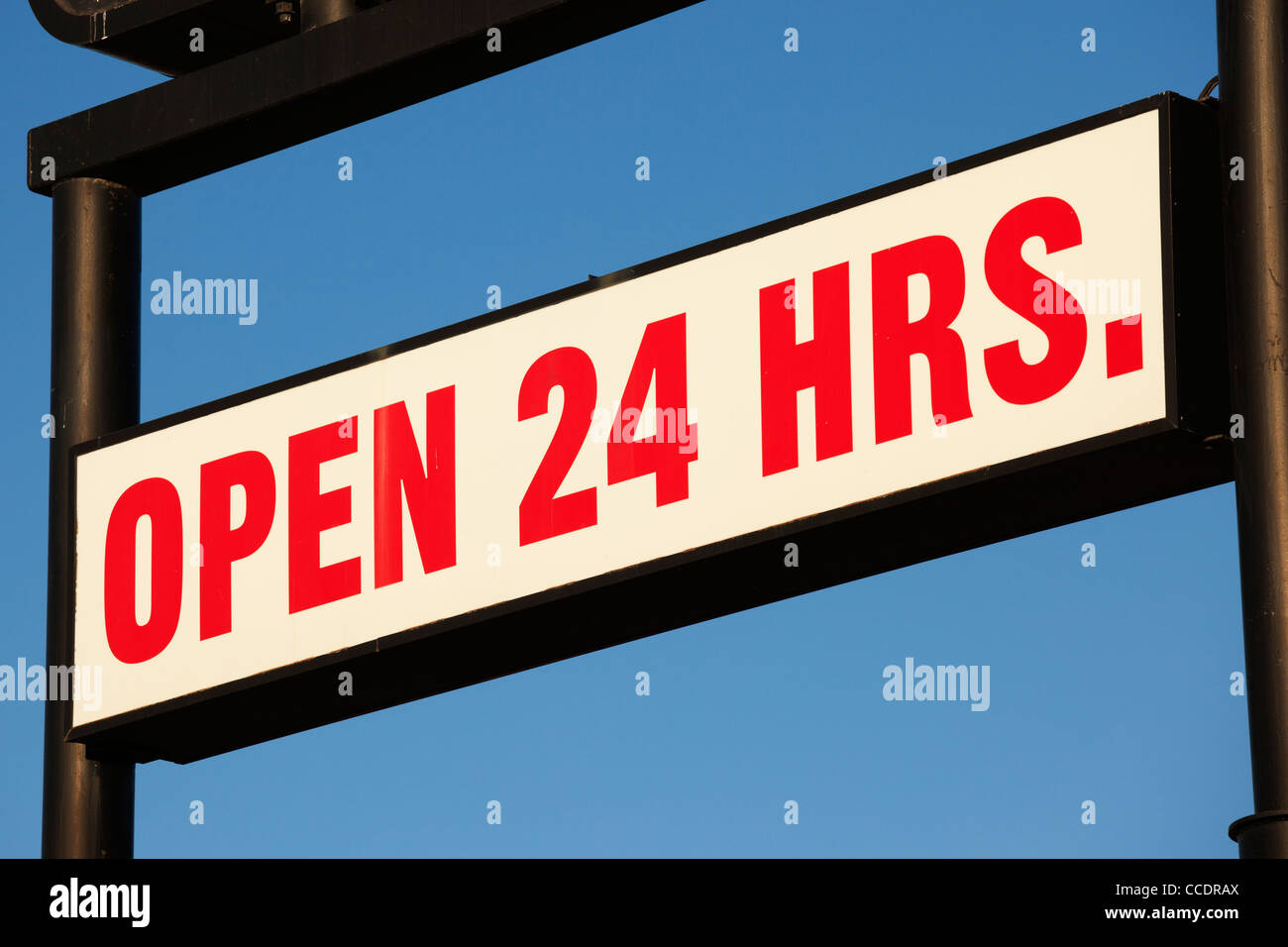 Service station sign that reads open 24 hours. - Stock Image