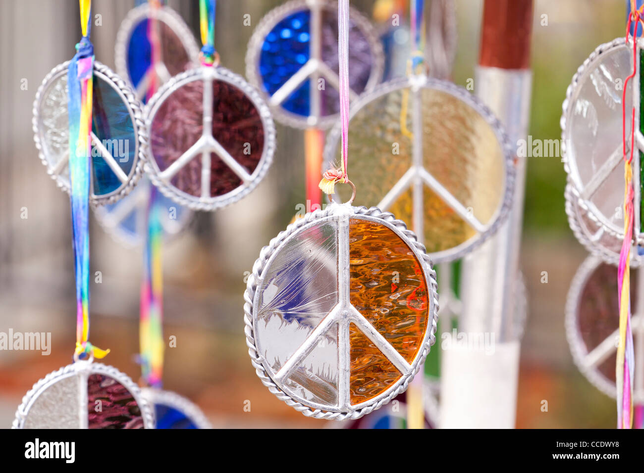 Stained glass peace medals - Stock Image
