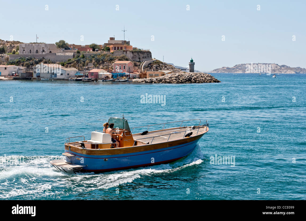 Couple Cruising on a Motorboat in Marseille, Provence, France - Stock Image