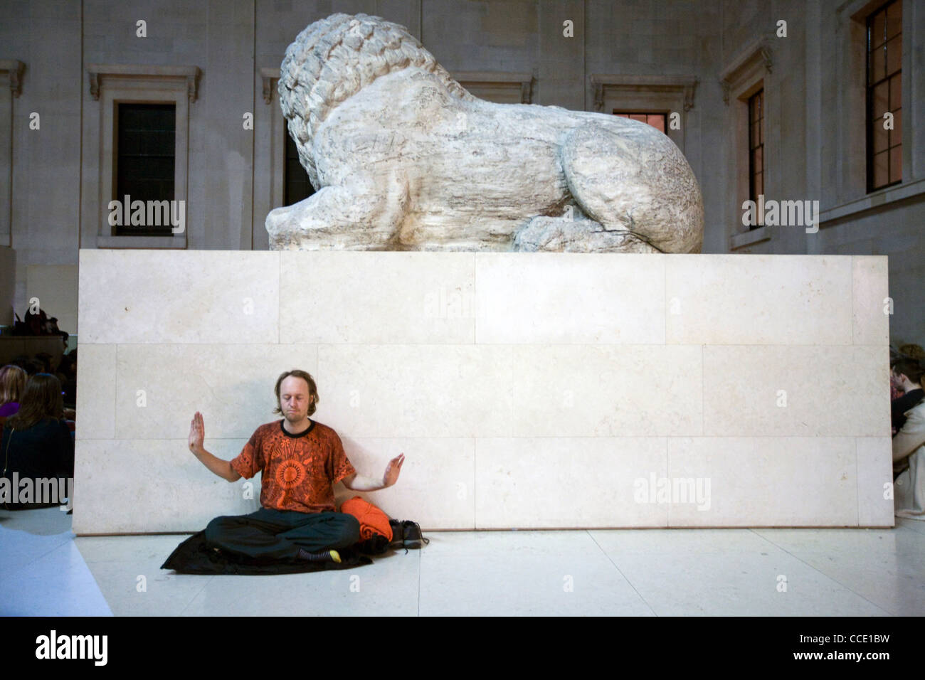 A man performs qi gong exercises - part of a meditation