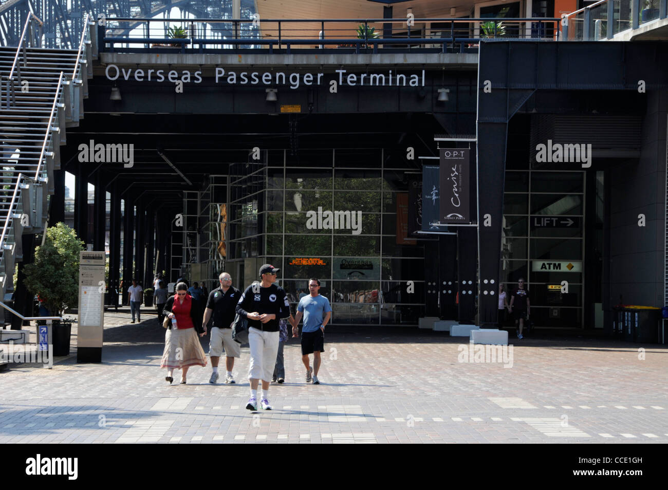 A small group of tourists emerging from the Overseas Passenger Terminal on Circular Quay in Sydney,New South Wales,Australia - Stock Image