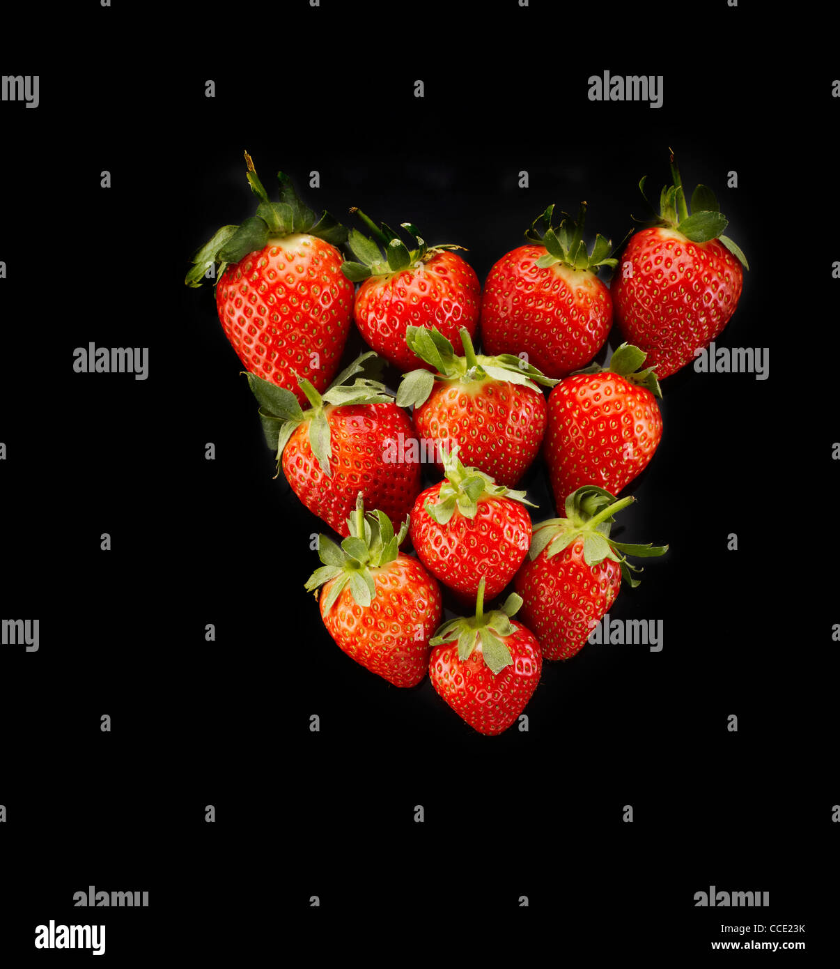 Strawberries in a triangular heart shape - Stock Image
