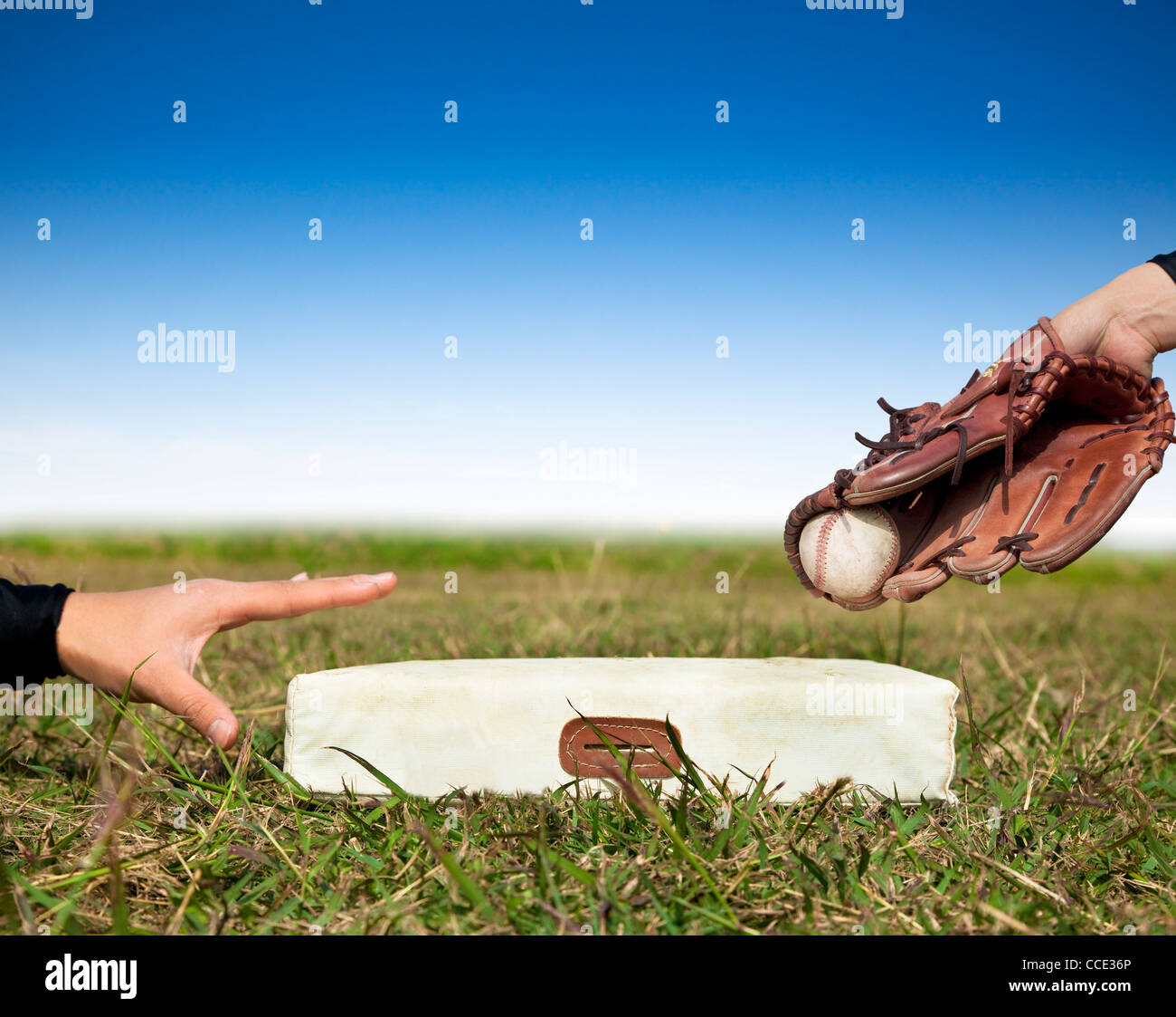 safe and force out concept.baseball player try to touch the base - Stock Image