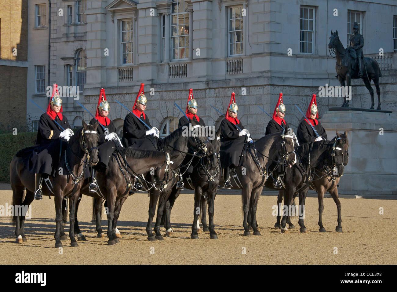 Seven guardsmen on horseback Horse Guards Parade London England - Stock Image