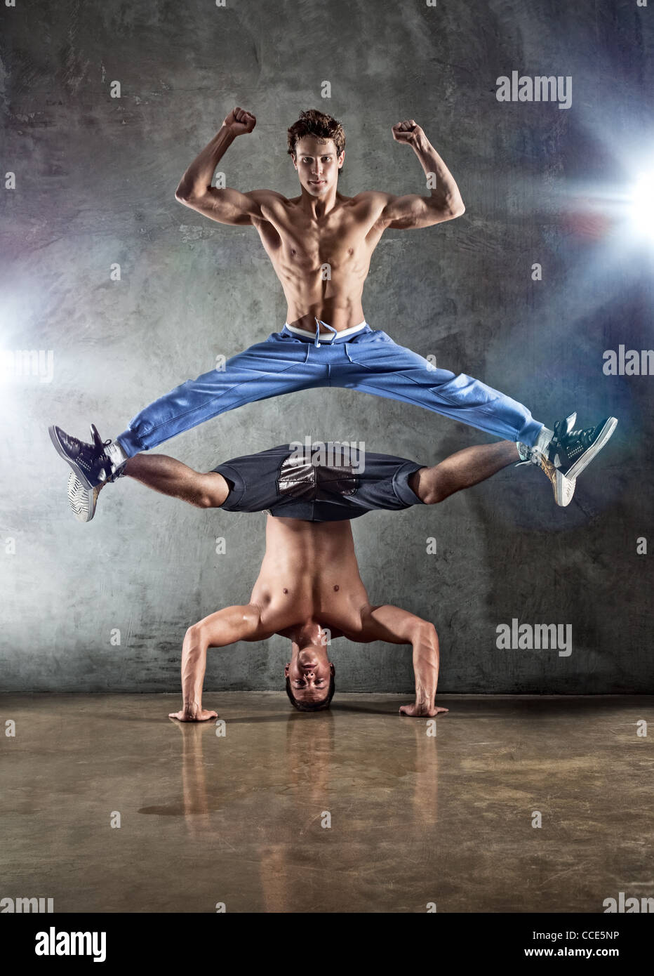 Two young strong men dancing. - Stock Image