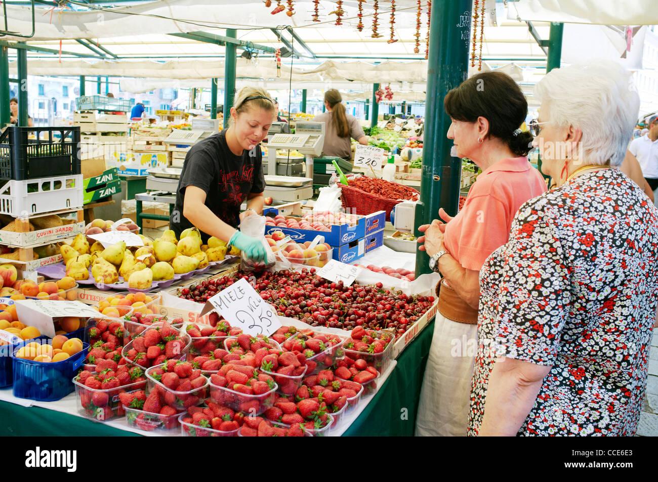 Woman selling fruit at Rialto market, Venice, Veneto, Italy. Stock Photo