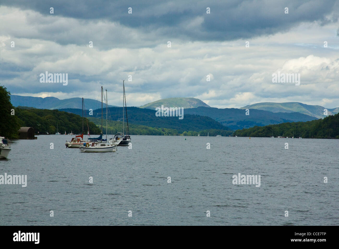 Anchored Sailing Boats under a stormy Sky, Lake Windermere, Cumbria, UK Lake District - Stock Image