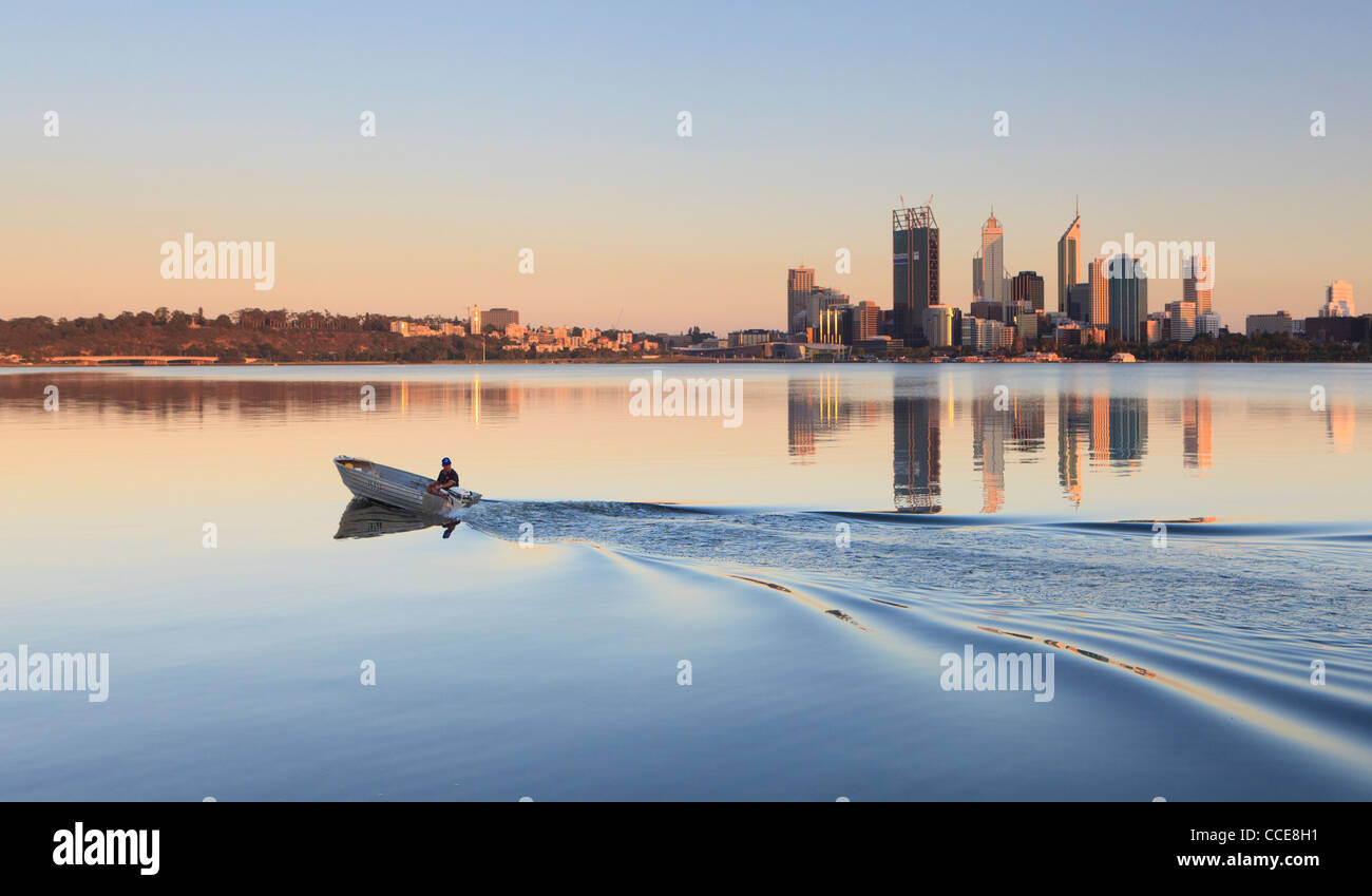 Boat on the the Swan River with Perth city in the distance. - Stock Image