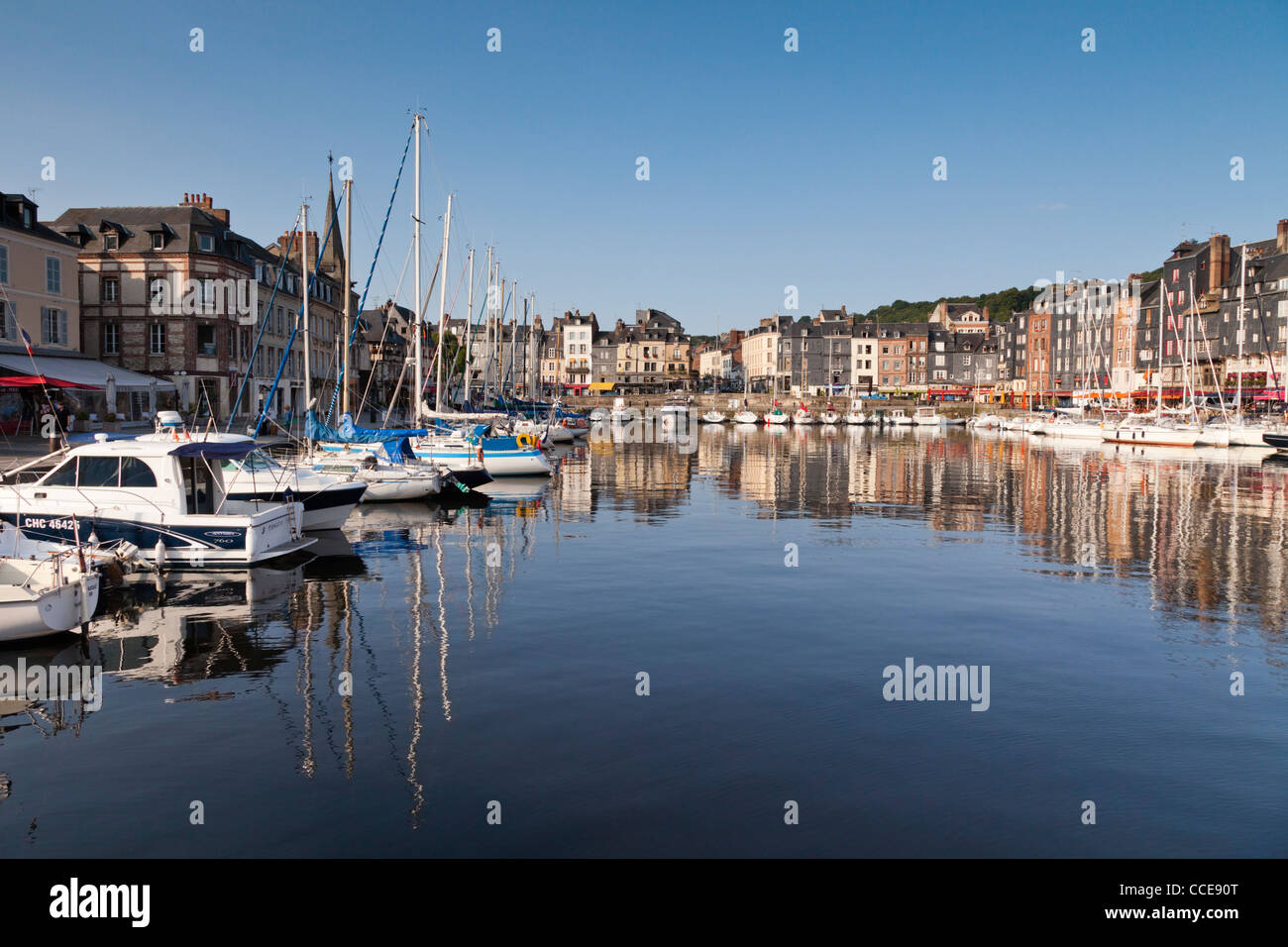 Sailing and power boats line the old harbour basin of Honfleur in Normandy, France. - Stock Image