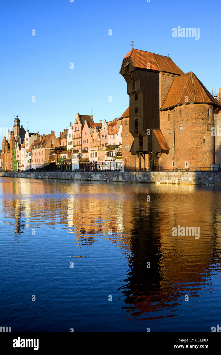 Early morning at scenic waterfront of the Old Town in Gdansk, Poland, on the right side of the image the Crane (Polish: - Stock Image