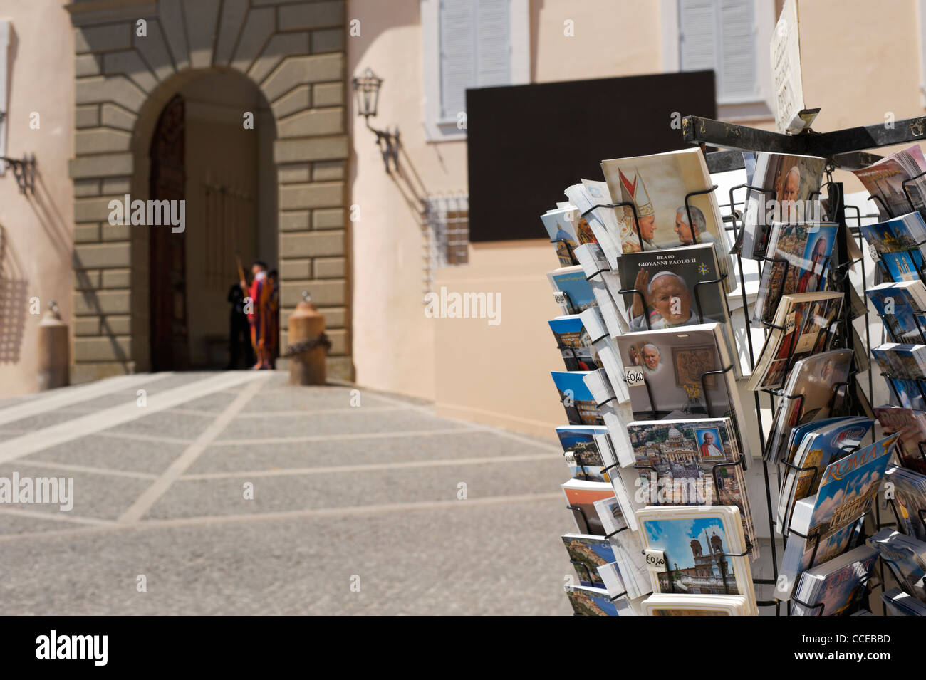 Castel Gandolfo postcards with Vatican building and Papal Swiss Guard - Stock Image