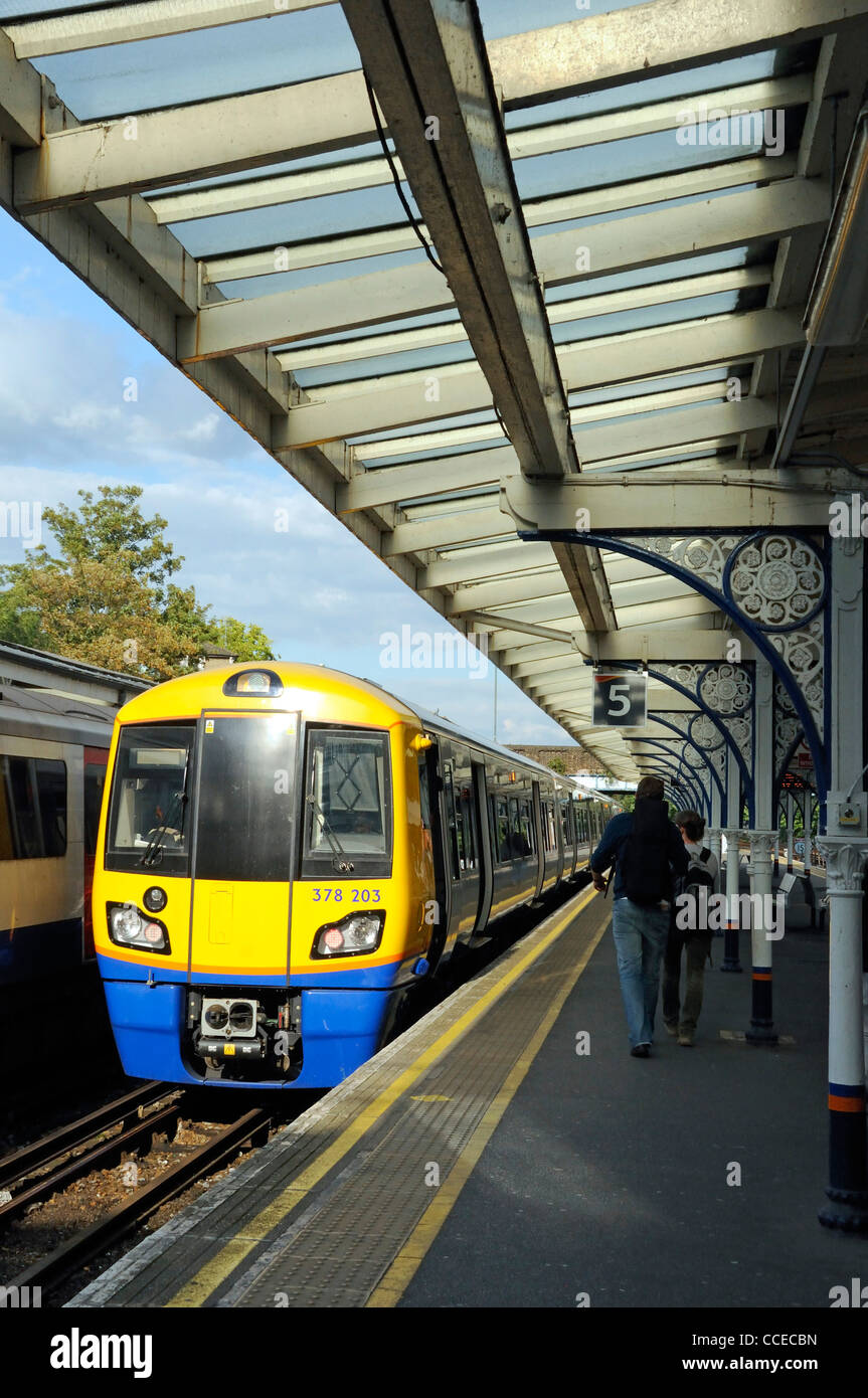 Overground train and platform with passengers Richmond Upon Thames Station Surrey England UK - Stock Image