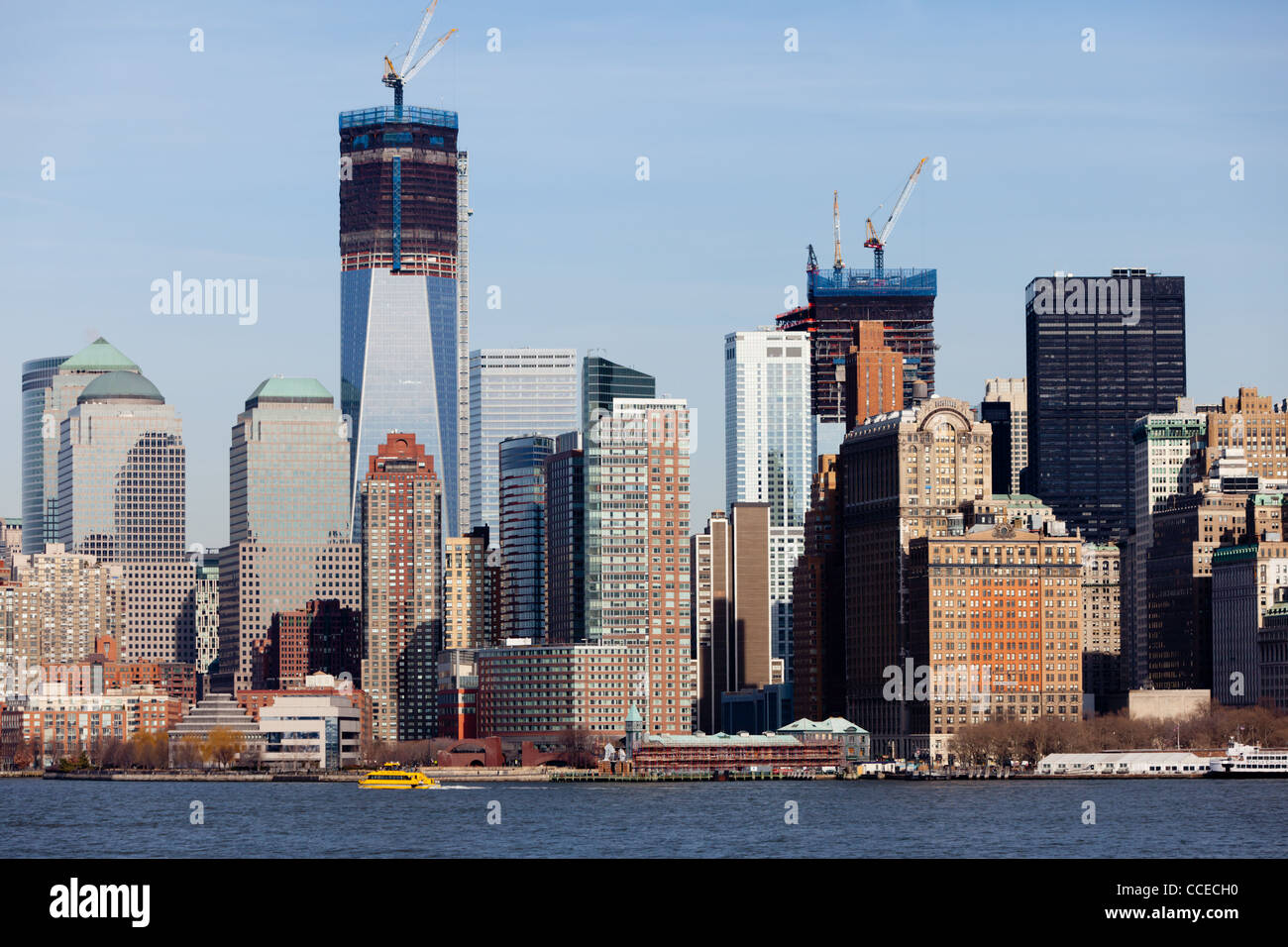The Manhattan skyline as seen from the Staten Island ferry during the daytime - featuring the new One World Trade - Stock Image