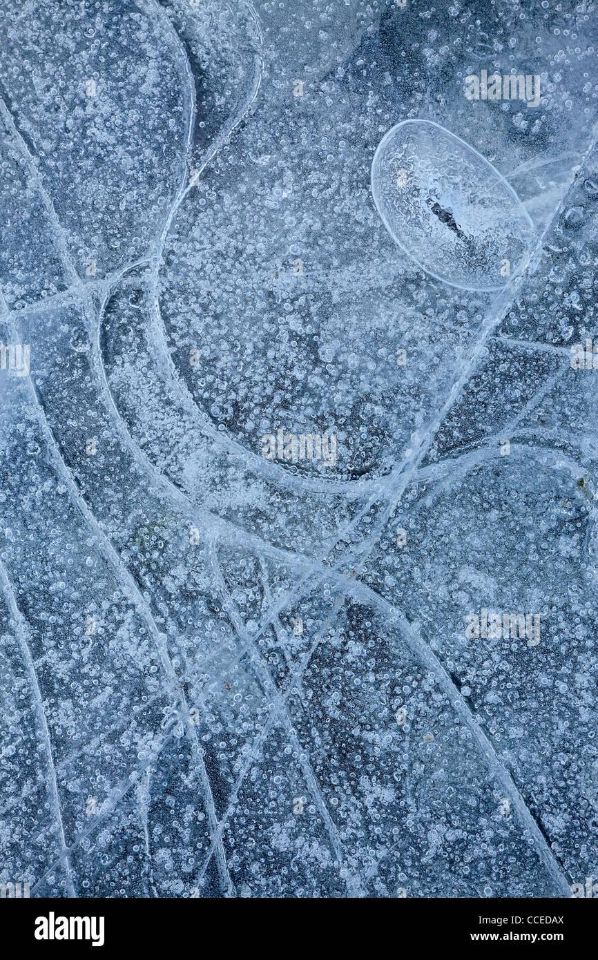 Ice patterns in along the frozen shoreline of Lake Tekapo in New Zealand - Stock Image