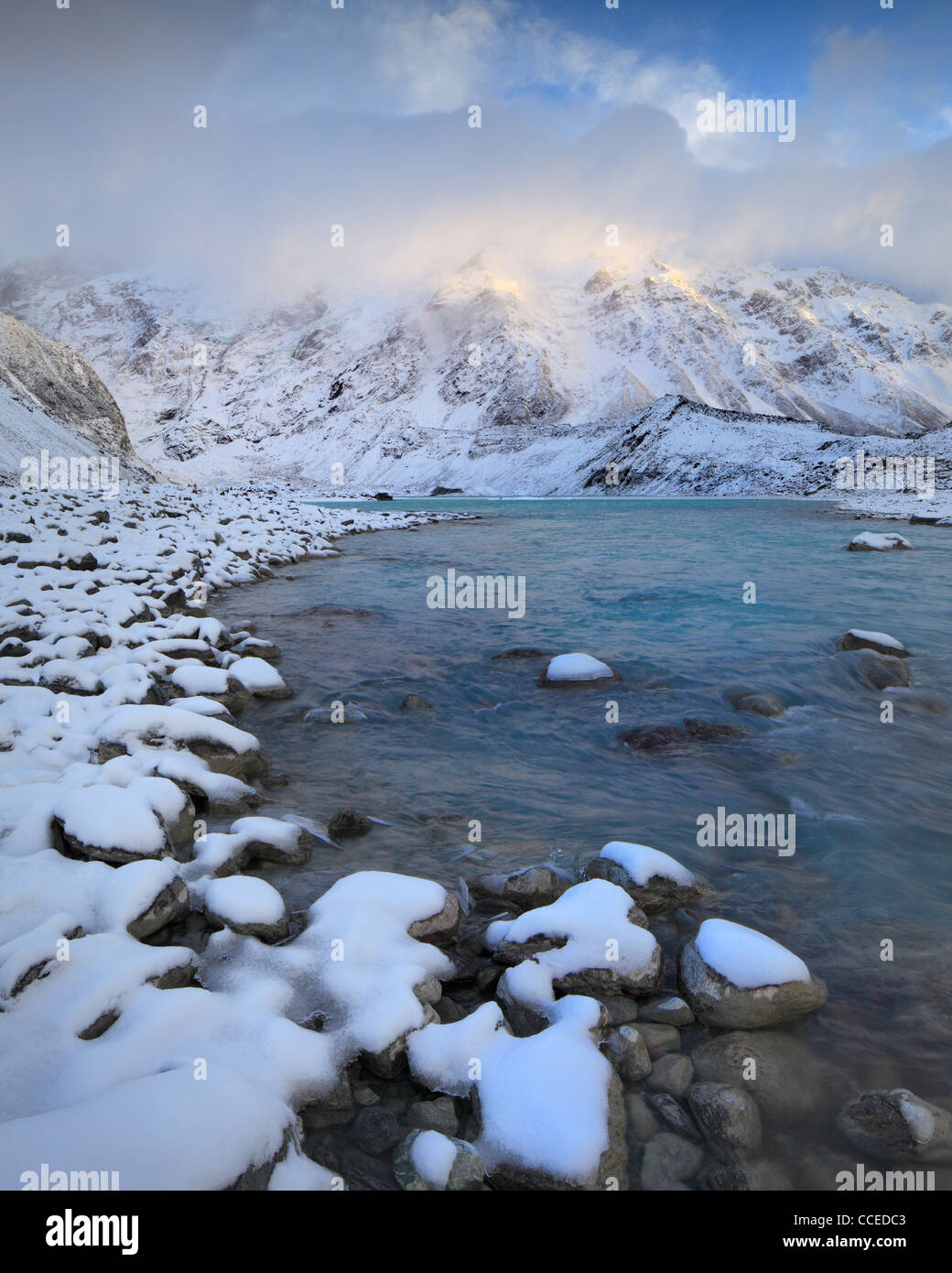 Clouds shroud Mt Sefton and The Footstool at sunrise as seen from the Hooker Valley in Mt Cook National Park, New - Stock Image