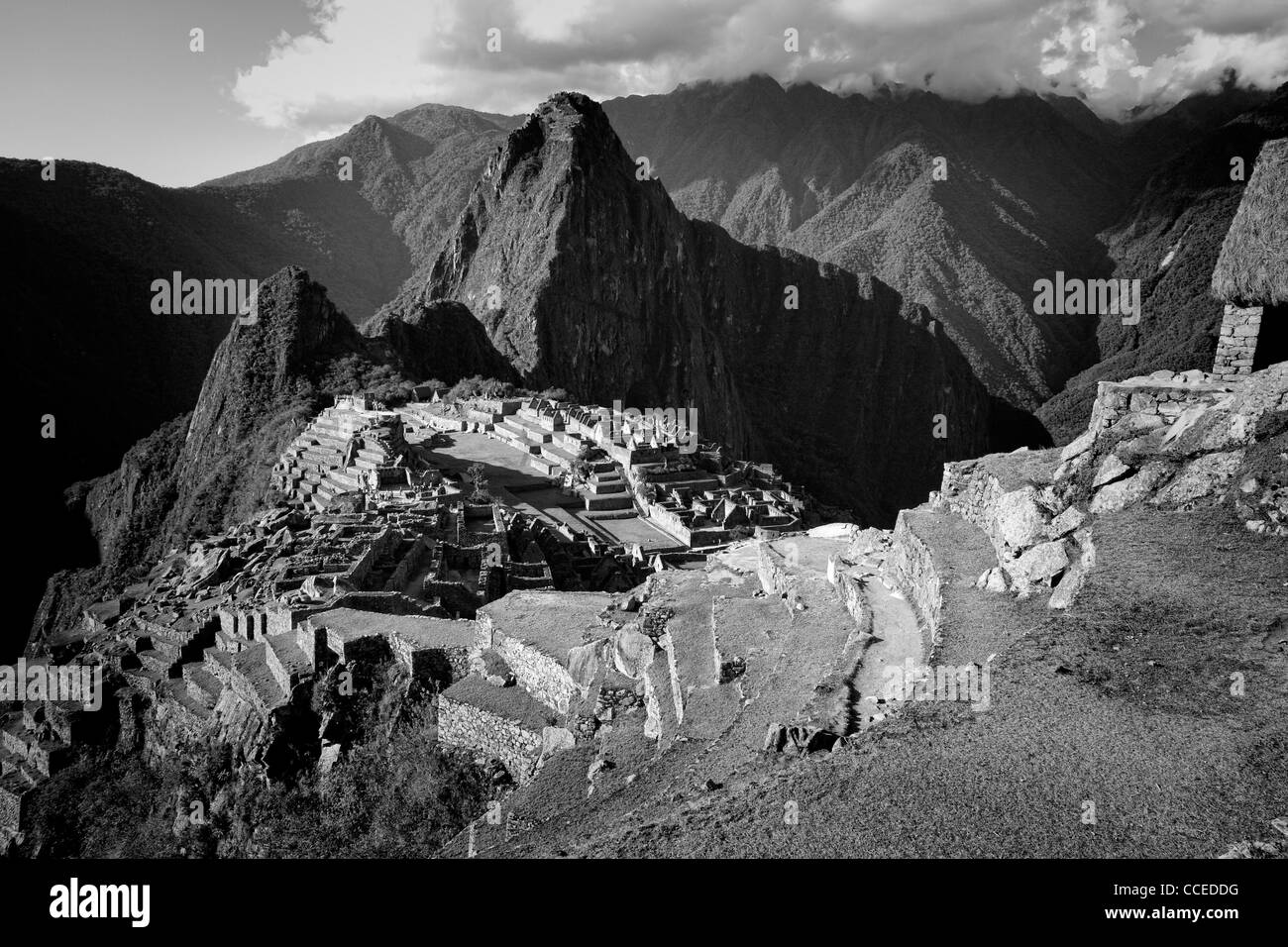 The ancient city of Machu Picchu hidden in the Andes mountains, Peru - Stock Image
