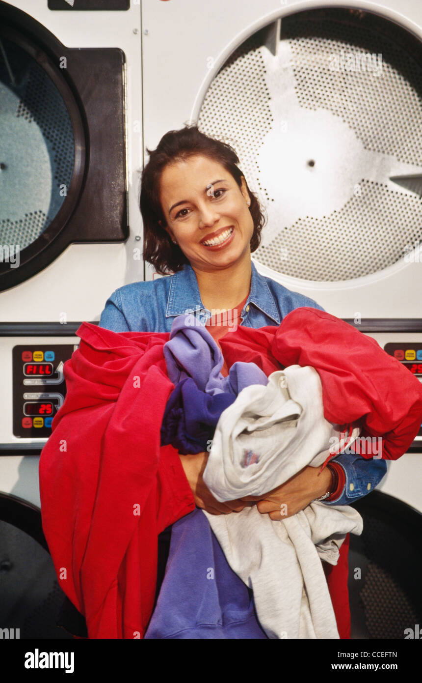 Young woman doing the laundry - Stock Image