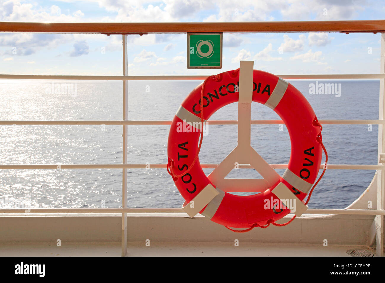 Costa Concordia cruise ship orange lifebuoy safety equipment fixed on open deck. The ship was wrecked due to collision - Stock Image