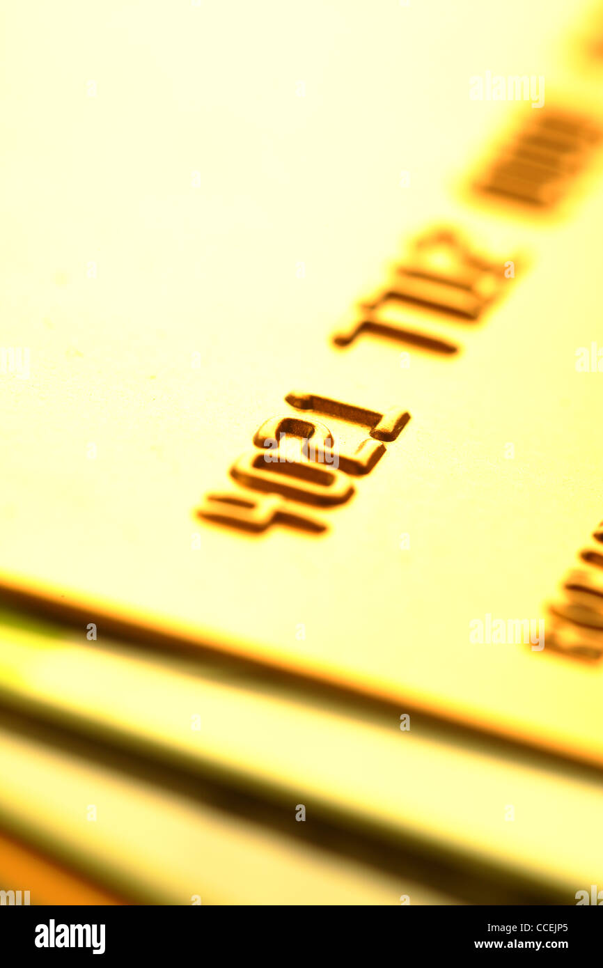 Gold credit cards close-up. Shalow DOF! - Stock Image