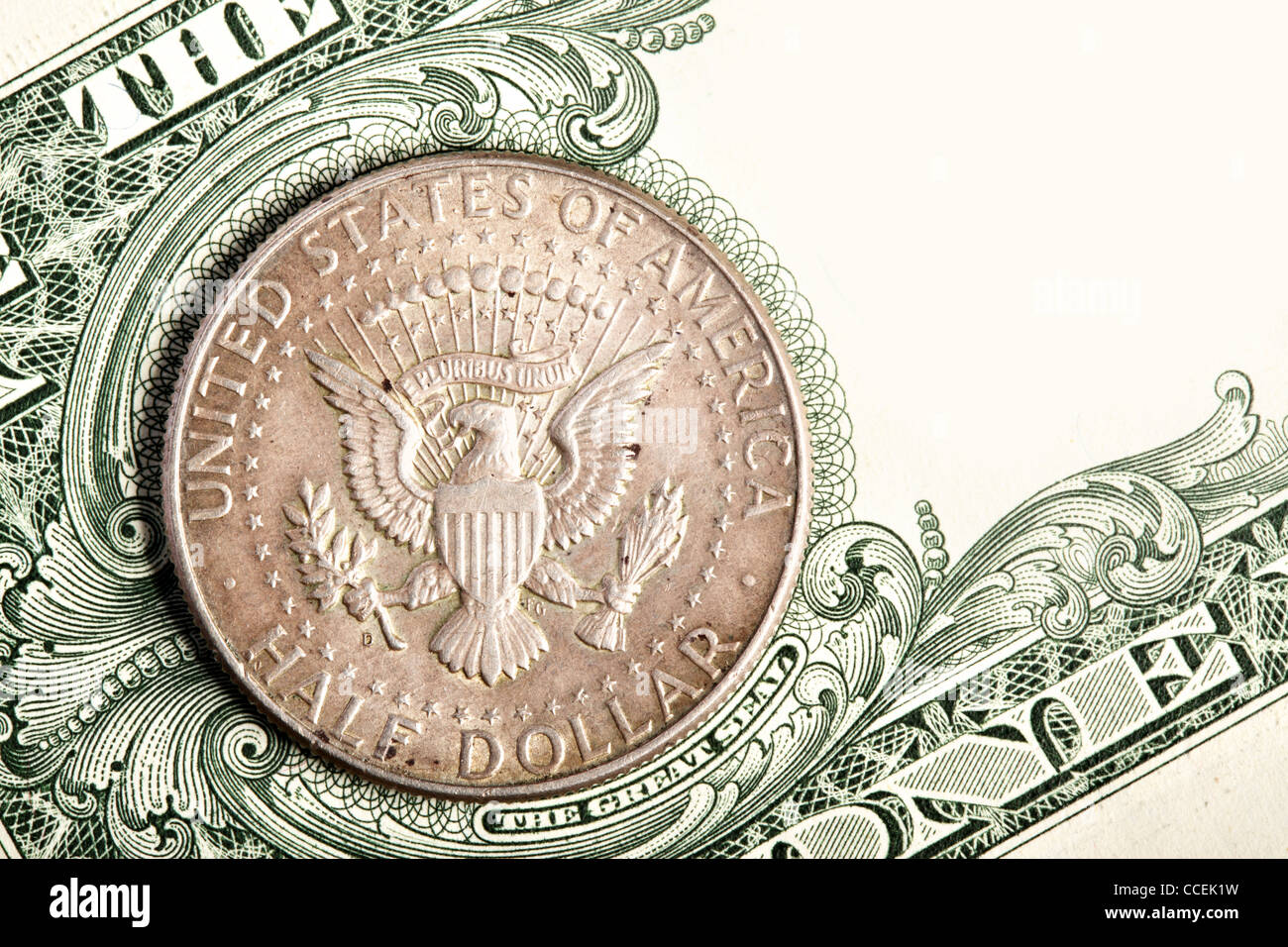 Half dollar coin close up on banknote - Stock Image