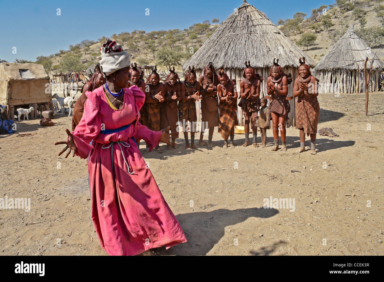 Himba women singing and dancing in village near Opuwo, Namibia - Stock Image