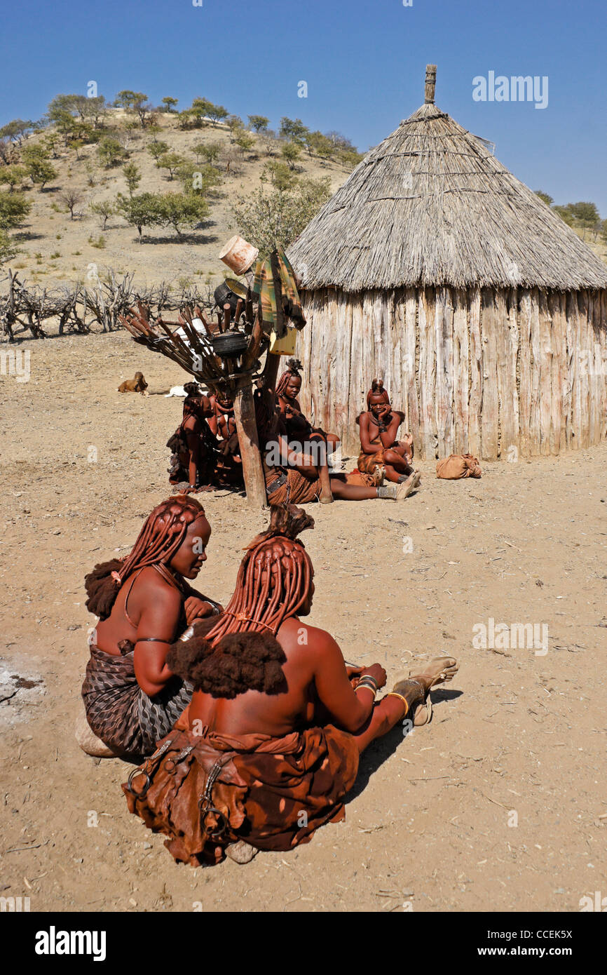 A Himba Woman At Her Village In Northern Namibia Stock