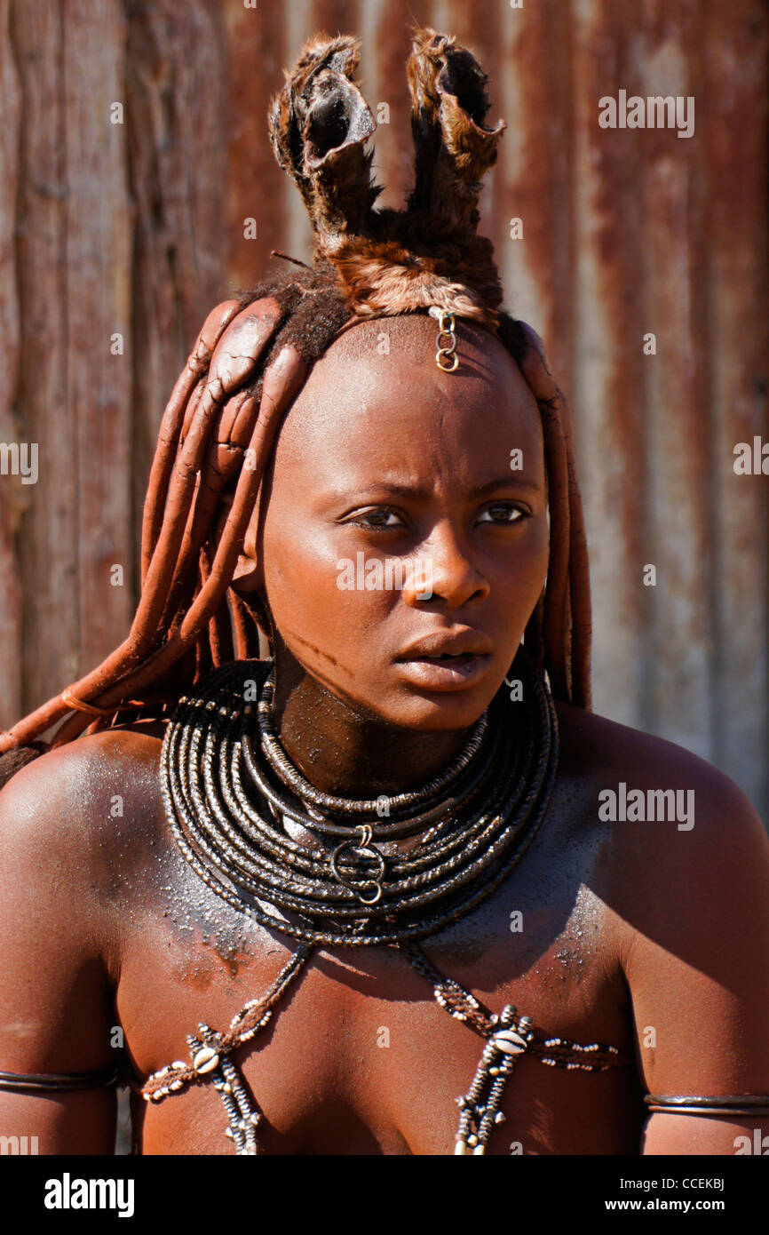 Married Himba woman with braided hair and erembe near Opuwo, Namibia - Stock Image