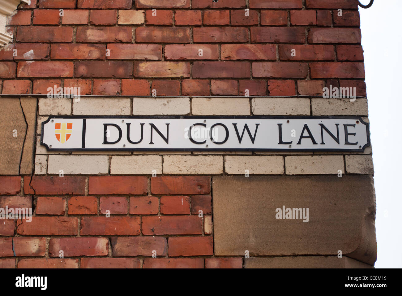 Street sign for Dun Cow Lane, a historic street in Durham City, England. - Stock Image