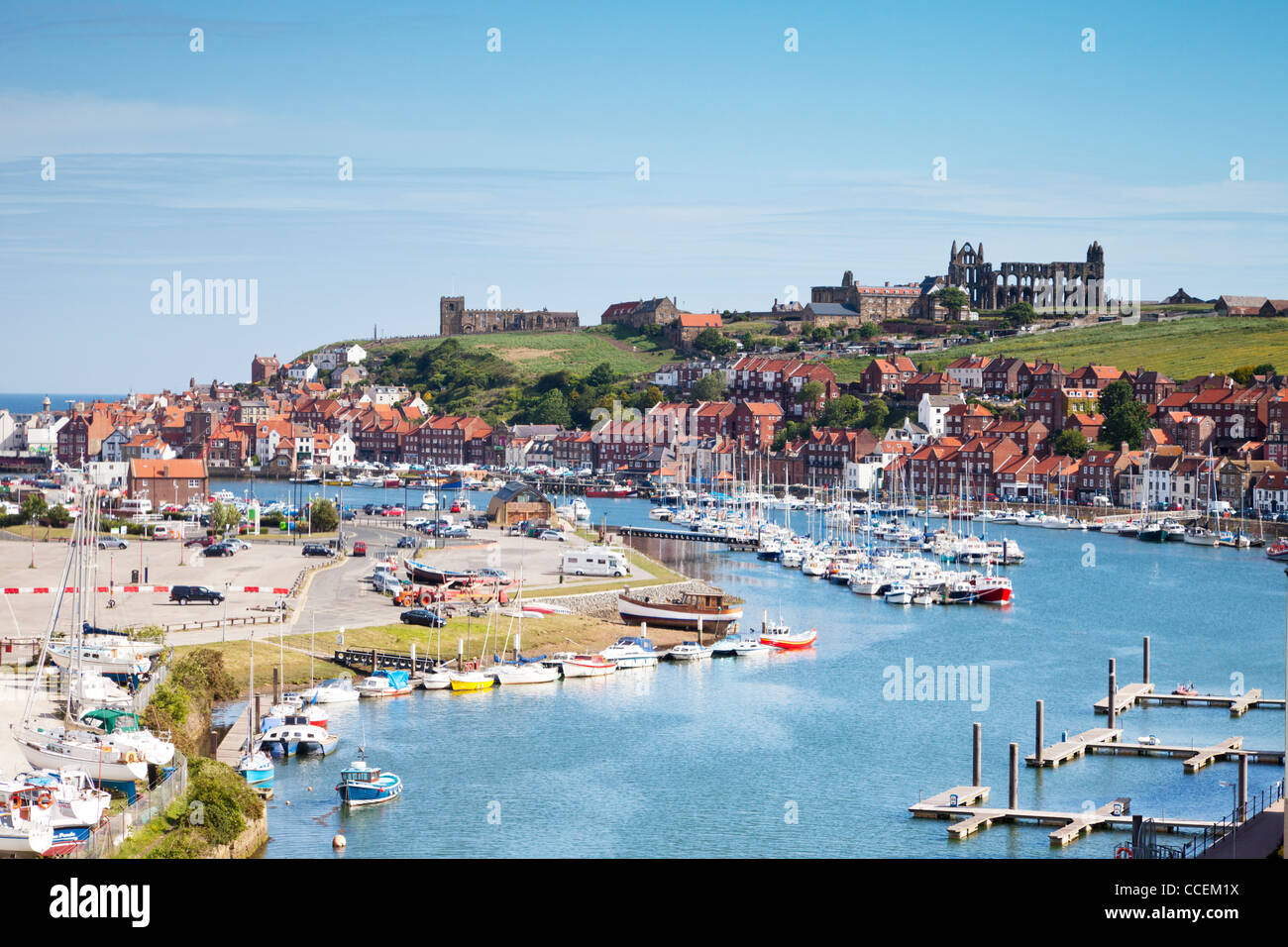 The North Yorkshire seaside town of Whiby, with its Abbey on the headland, the River Esk, and houses clustered around - Stock Image