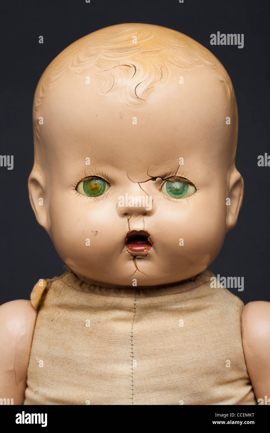 A scary-looking vintage infant doll. Stock Photo