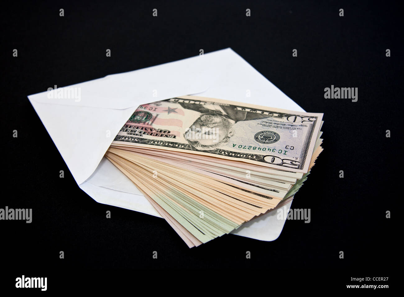 Notes coming out an envelope - Stock Image