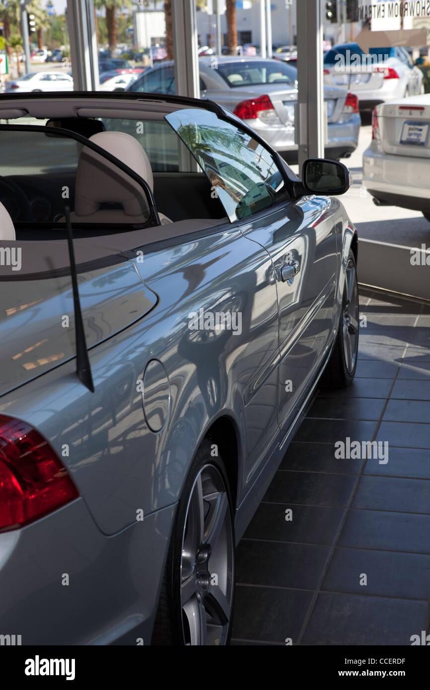 Luxury car stationary at showroom - Stock Image