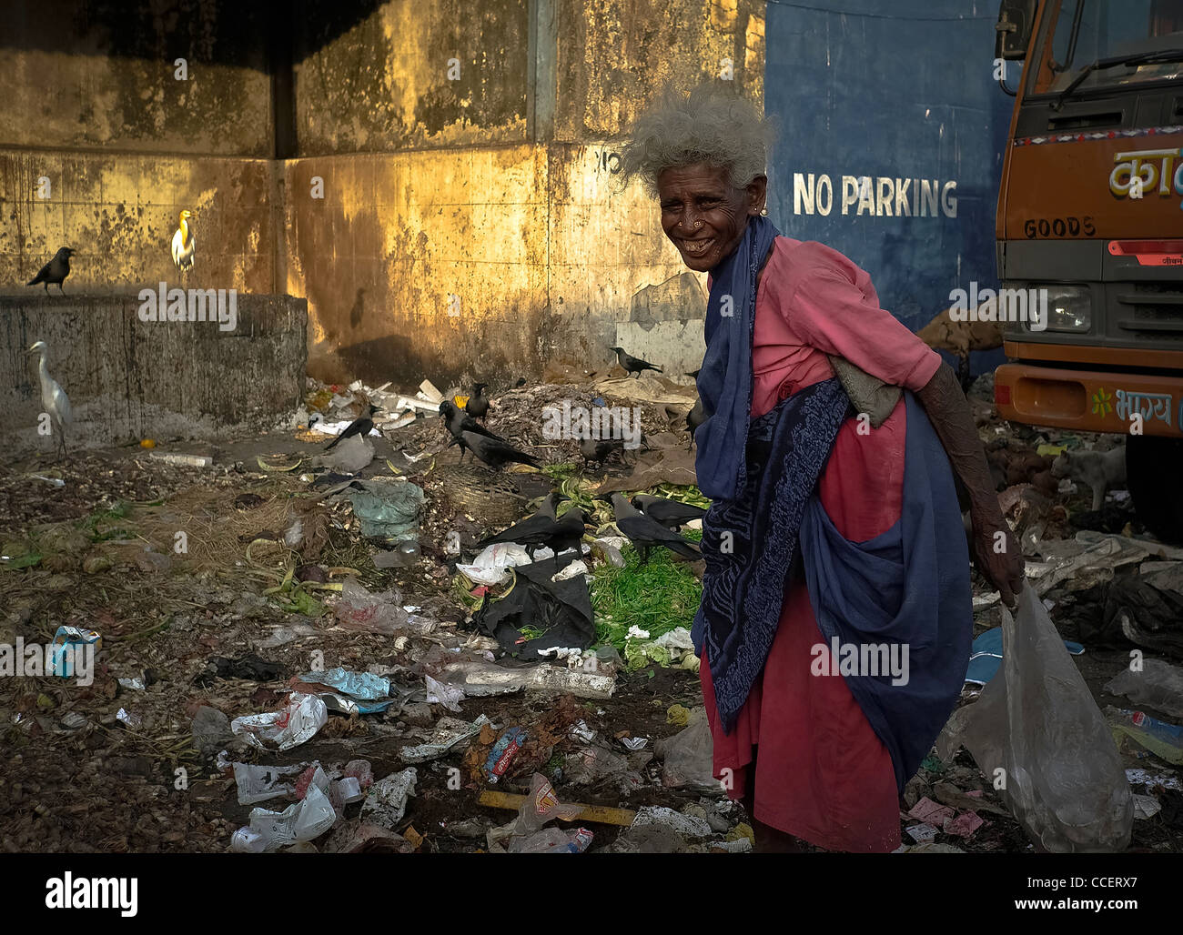 Untouchable and disabled Bombay., Food in the garbage. - Stock Image