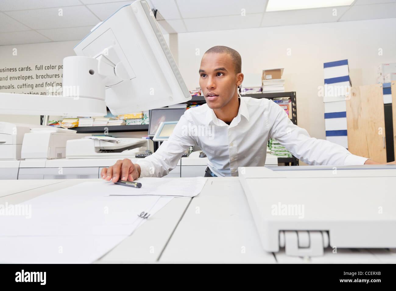 Man looking at visual screen - Stock Image