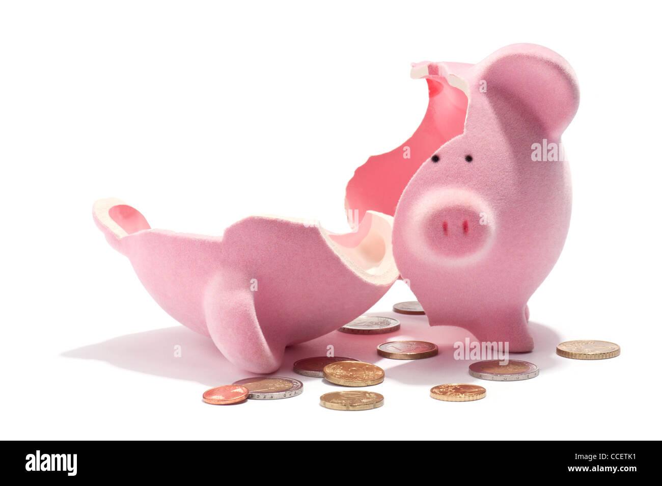 A broken piggy bank and Euro coins Stock Photo
