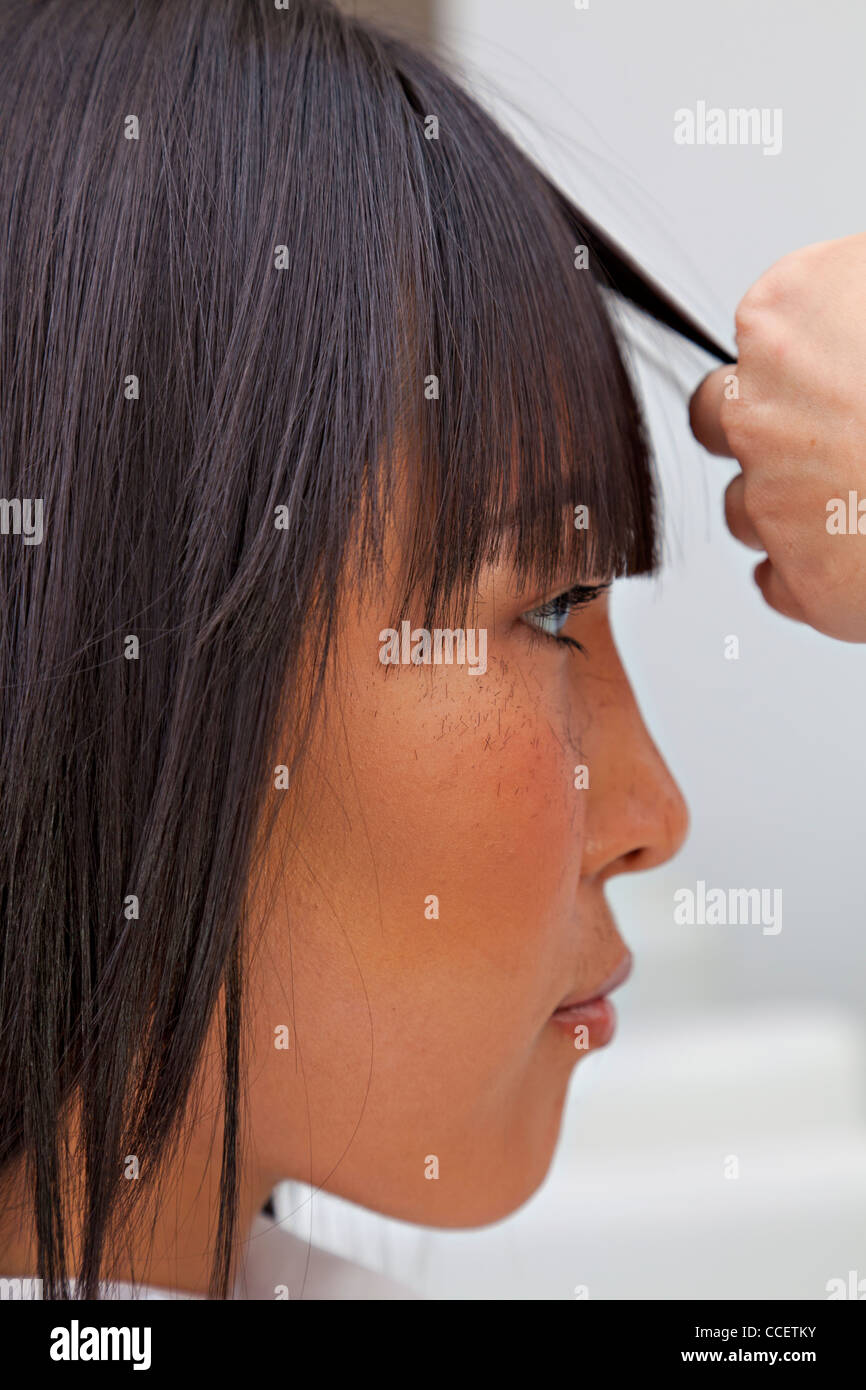 Super Side View Of Asian Woman Getting A New Haircut Stock Photo Schematic Wiring Diagrams Phreekkolirunnerswayorg