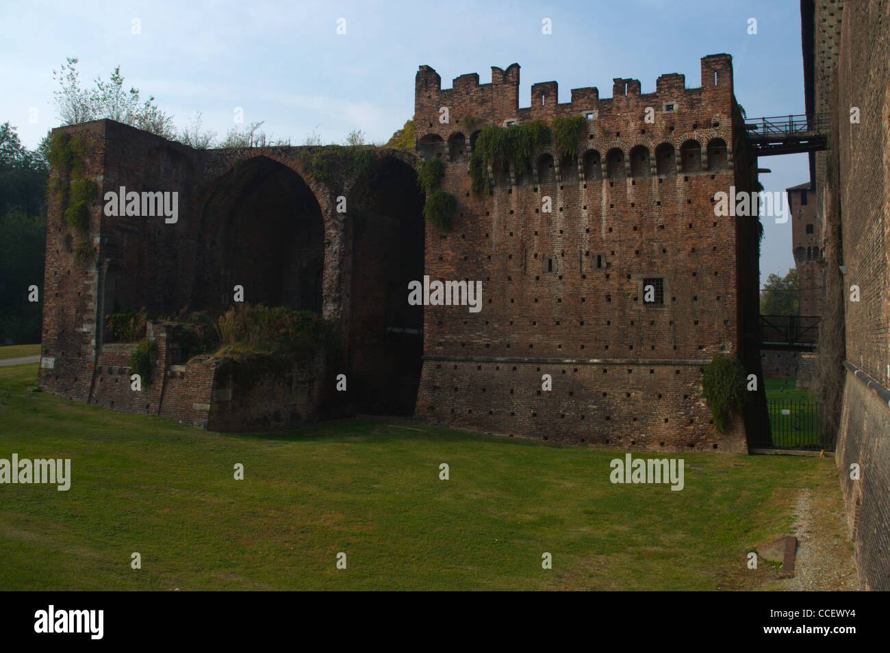 Moats dried by Napoleon in early 18th century encircling the walls of Castello Sforzesco castle Milan Lombardy region - Stock Image