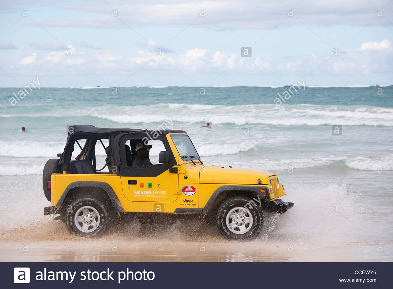 jeep on the seashore,the area of Punta Cana,Hispaniola,Dominican Republic,Caribbean - Stock Image