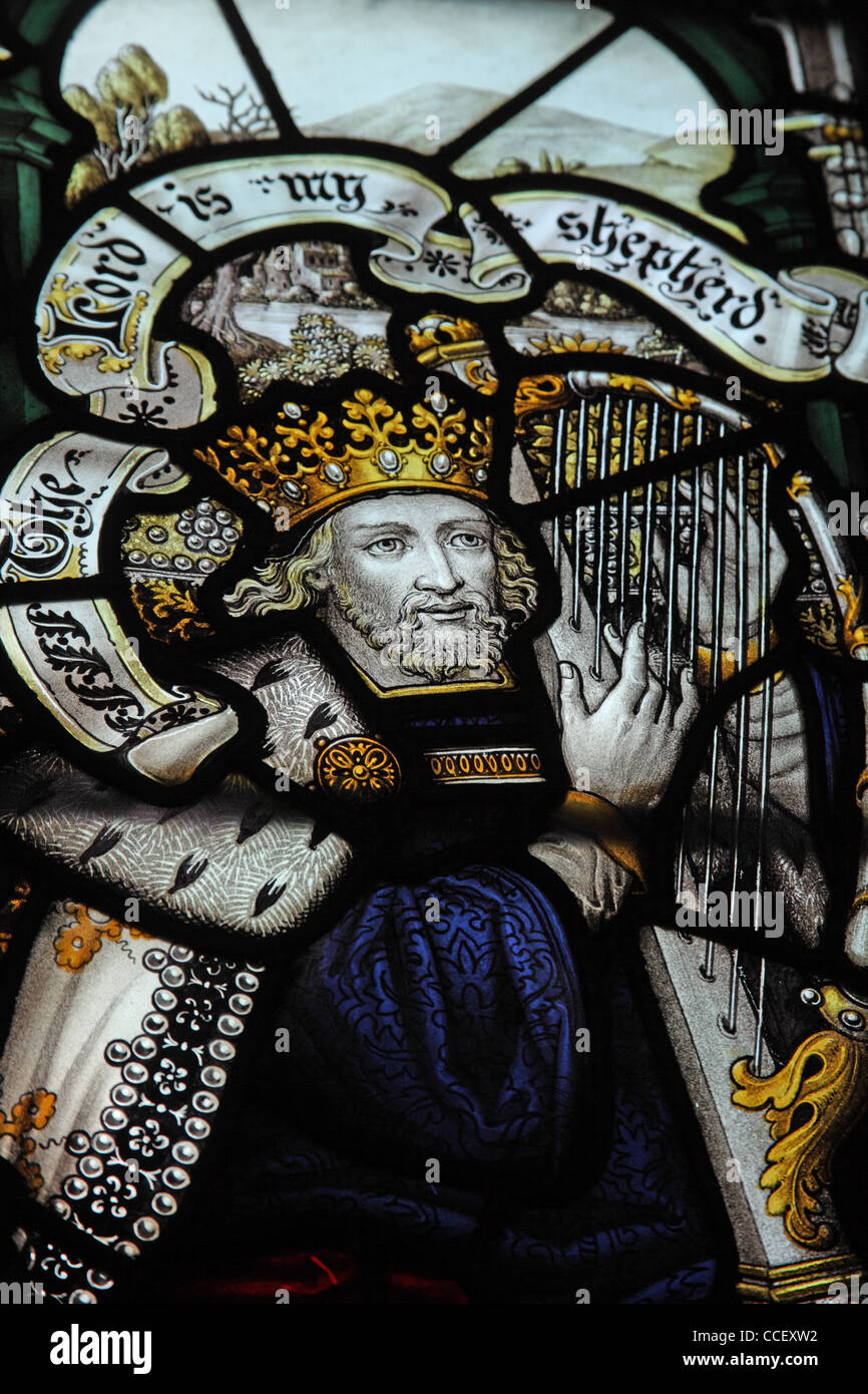 A stained glass window by C E Kempe & Co. depicting King David, All Saints Church, Hough-on-the-Hill, Lincolnshire - Stock Image
