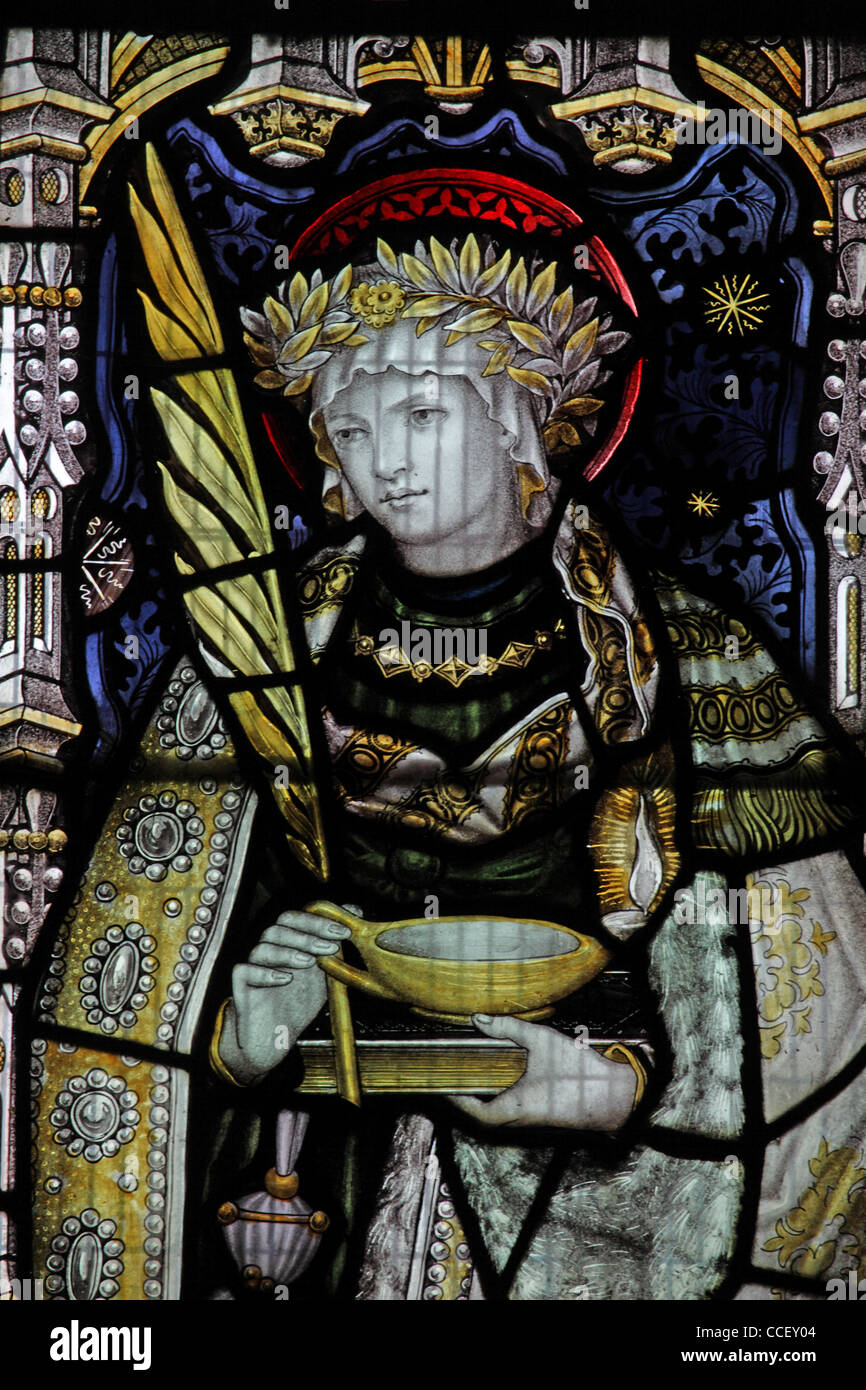 A stained glass window by C E Kempe & Co. depicting Saint Lucy, Church of St Nicholas, Carlton Scroop, Lincolnshire - Stock Image