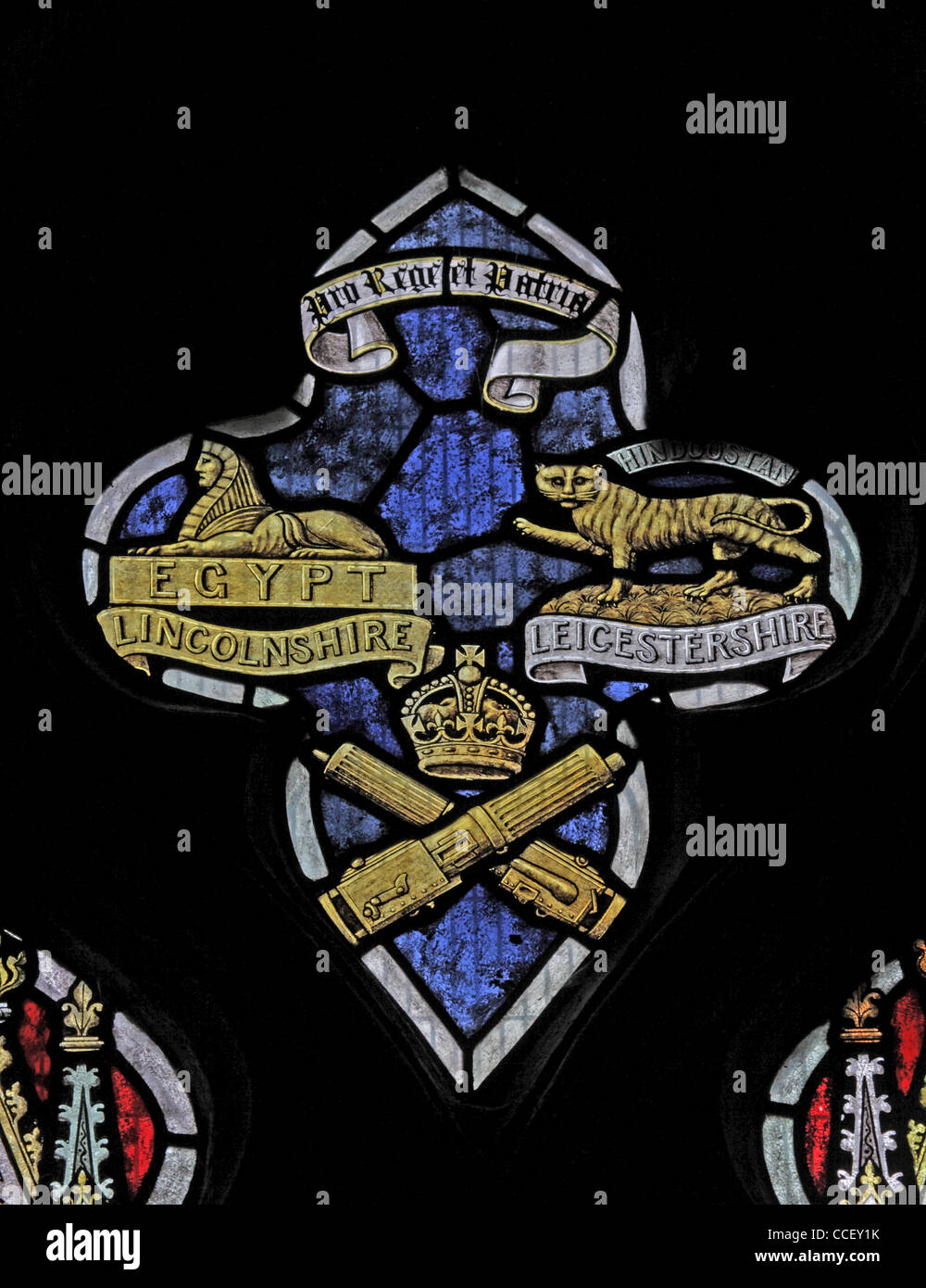 A stained glass window depicting the cap badges of the Lincolnshire and Leicestershire Regiments - Stock Image